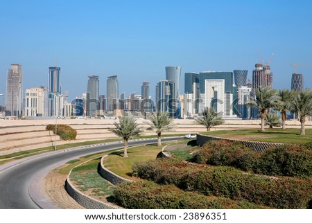 A view of the emerging skyline in Doha, the capital city of Qatar, Arabia, seen from inland. - stock photo