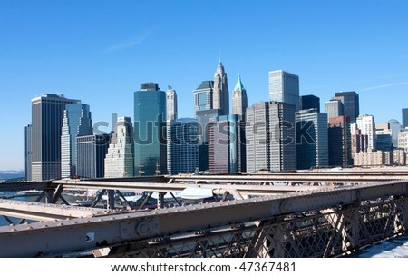 A view of the financial district skyline, Manhattan from the Brooklyn bridge - stock photo