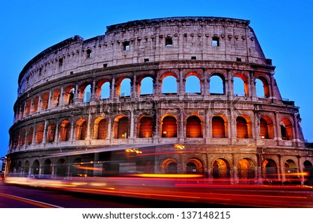 A view of the Flavian Amphitheatre or Coliseum at sunset in Rome, Italy - stock photo
