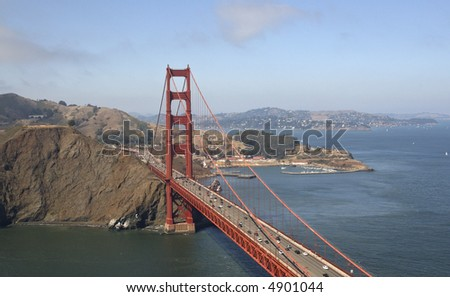 A view of the Golden Gate Bridge from the helicopter flying over, looking to Marin Headlands and Fort Mason. - stock photo