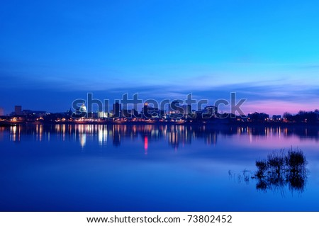 A view of the Harrisburg, Pennsylvania cityscape and state capitol overlooking the Susquehanna River at sunrise. - stock photo