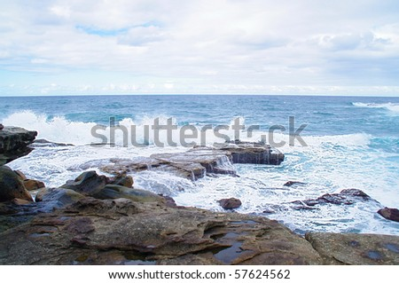 A view of the huge surf crashing on the cliffs around famous Bondi, Bronte and Tamarama beach, Australia - stock photo