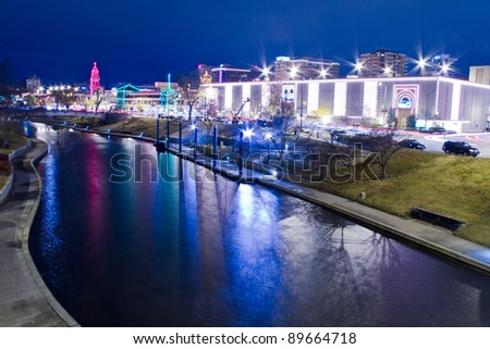 A view of the Kansas City Country Club Plaza Christmas lights and the skyline of downtown Kansas City, Missouri - stock photo