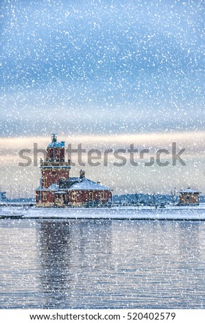 A view of the lighthouse at the swedish city of Helsingborg during some wintry weather conditions.