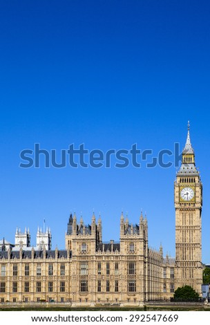 A view of the magnificent architecture of the Palace of Westminster in London. The towers of Westminster Abbey can be seen in the distance. - stock photo