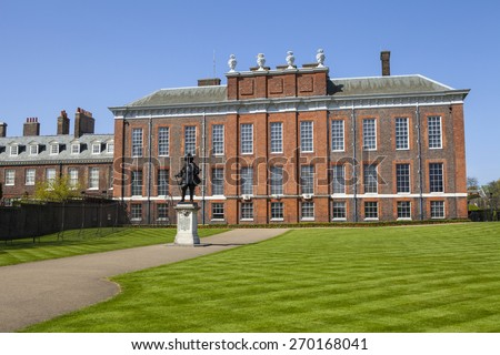 A view of the magnificent Kensington Palace in London with the statue of King William III in the foreground.