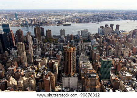 A view of the Manhattan cityscape facing East towards Brooklyn from the Empire State Building in New York, NY.