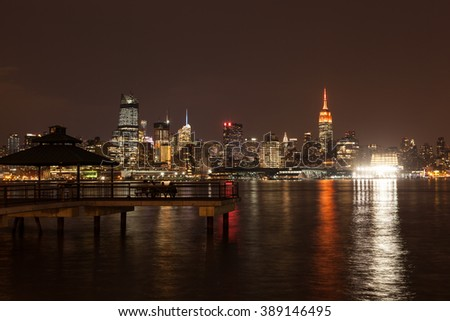 A view of the Midtown Manhattan skyline at night taken from the Hoboken waterfront in March, 2016. - stock photo