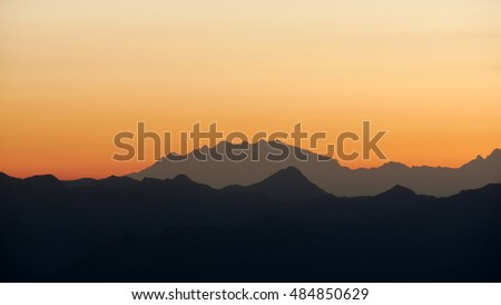 a view of the Monte Rosa massif at sunset.
