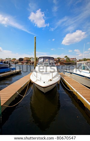 A view of the private motor yacht, docked in the marina. - stock photo