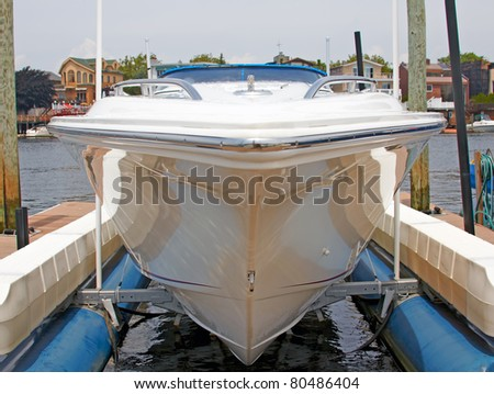 A view of the private yacht's bow, docked in the marina. - stock photo