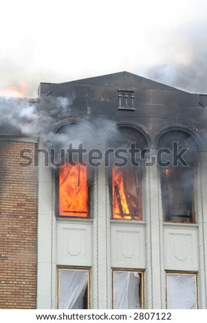 A view of the raging fire in the windows of an apartment - stock photo