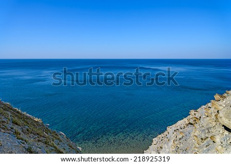 A view of the sea between cliffs - stock photo