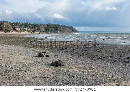 A view of the shoreline in Normandy Park, Washington on a windy day. - stock photo