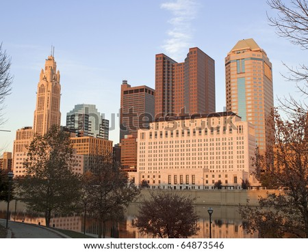 A view of the skyline of Columbus, Ohio at sunset. - stock photo
