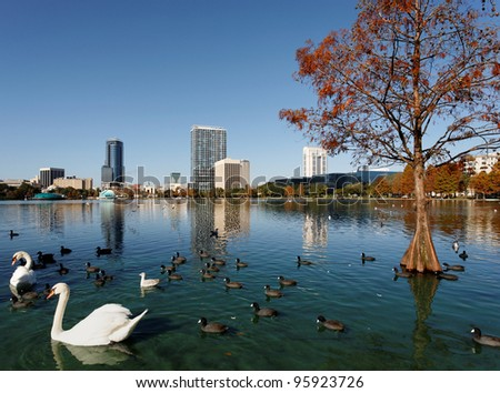 A view of the skyline of Orlando, Florida from across Lake Eola. - stock photo