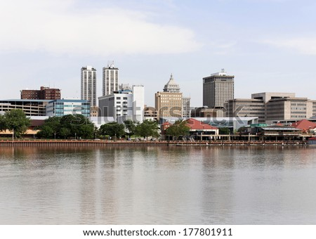 A view of the skyline of Peoria, Illinois from across the Illinois River. - stock photo