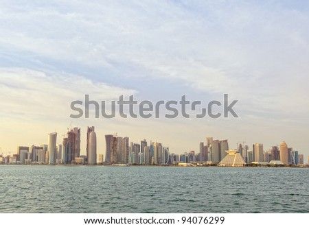 A view of the skyline of the Dafna area of Doha, Qatar, at sunset from across Doha Bay, January 2012 - stock photo