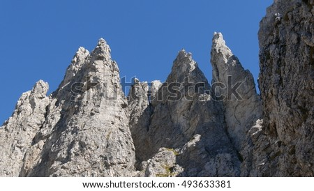a view of the spectacular rock walls of the mount southern Grigna, Lombardy, Italy.  It is a beautiful and famous place for alpinism and climbing.