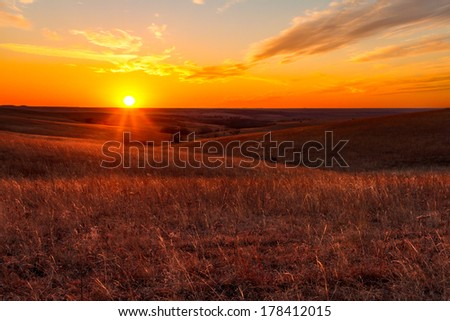 A view of the sunset in the Flint Hills of Kansas just outside of Alma, Kansas - stock photo