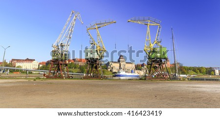 A view of the Szczecin town, the old city, and crane in the old shipyard.  Poland, Eastern Europe.