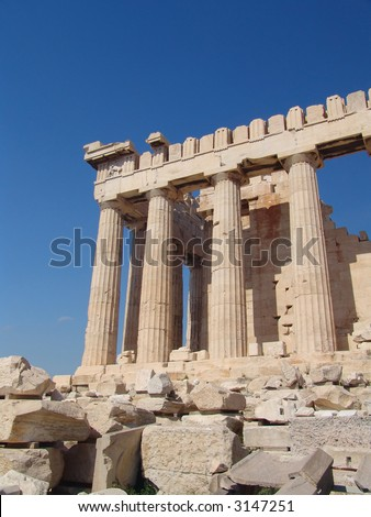 A view of the temple on the Acropolis hill over a blue sky - stock photo
