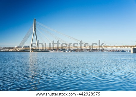 A view of the Vansu bridge over Daugava River in Riga, Latvia - stock photo