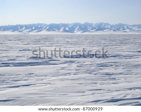 A view of the vast arctic landscape from the edge of the Arctic Ocean. - stock photo