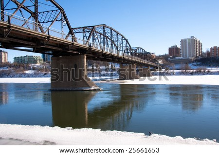A view of the Victoria Bridge in Saskatoon, Canada on a sunny day in winter. - stock photo