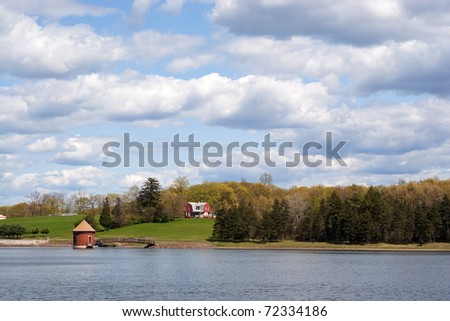 A view of the water at the public drinking water reservoir on the New Britain Southington town line in Connecticut. Fishing here is prohibited. - stock photo
