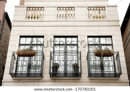 A view of three beautiful balconies for a home in the US. - stock photo