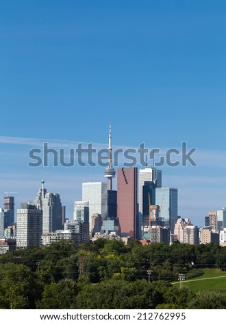 A view of Toronto from the East during the day, with logos removed from buildings - stock photo