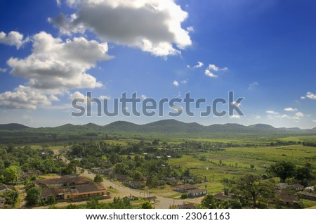 A view of tropical rural landscape with valley and settlement - sierra del escambray, cuba - stock photo