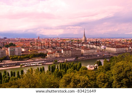 a view of Turin with a famous Mole Anttonelliana at a sunset - stock photo