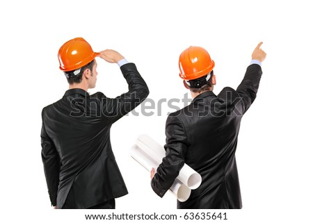 A view of two architects in a suit looking isolated on white background - stock photo