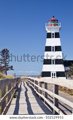 A view of West Point Lighthouse in rural Prince Edward Island, Canada. - stock photo