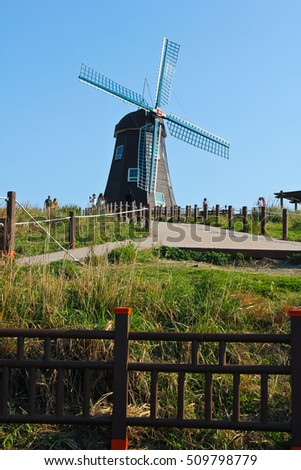 A view of windmill on the hill, the southern coast of Korea / windmill on the hill