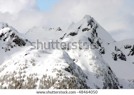 A view of winter mountain snow peak near BC, Canada. - stock photo