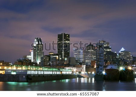 A view on Montreal skyscrapers and downtown and the docks in the early morning.