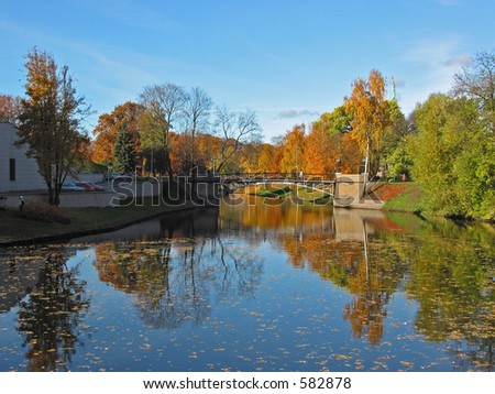 A view on the city river in autumn - stock photo