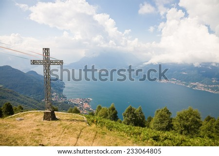 A view on the Como Lake from the cross at Camaggiore in the town of Vendrogno near Bellano, Lombardy, Italy - stock photo