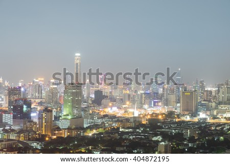 a view over the Bangkok city of Thailand at nighttime when the tall skyscrapers are illuminated, Combining housing, expressway, bird eye view the city at night show light of the building, background