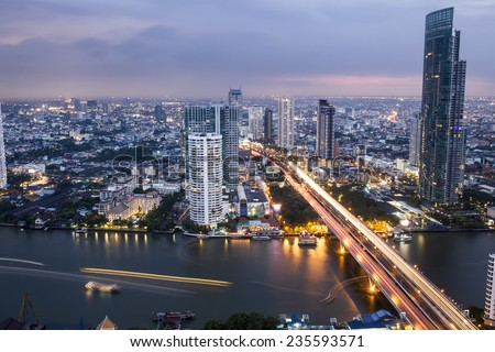 a view over the big asian city of Bangkok, Thailand at nighttime - stock photo