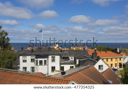 A view over the medieval town Visby, Sweden on Gotland with the Baltic sea and the Visby city flag in the background