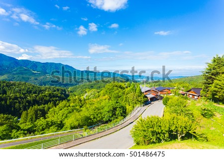 A view overlooking Kiso Valley above Magome village on the Nakasendo Route in Japan on a blue sky day
