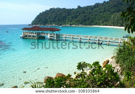 A view to clear blue water and a beach on Perhentian Besar in Malaysia