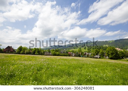 A view towards to town district of Zakopane, it shows the beauty of through a completely vegetated part of the city - stock photo