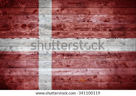 A vignetted background image of the flag of Denmark painted onto wooden boards of a wall or floor. - stock photo