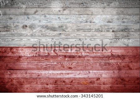 A vignetted background image of the flag of Poland onto wooden boards of a wall or floor. - stock photo
