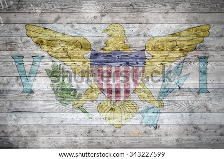 A vignetted background image of the flag of Virgin Islands onto wooden boards of a wall or floor. - stock photo